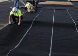 Installers can put down 50,000 sq. ft. of PRECON in a day, according to contractors at Marina Heights. Firestop Southwest's Tracy Smith notes that this is about double the installation rate for the same 6-7 man crew putting down bentonite sheets.